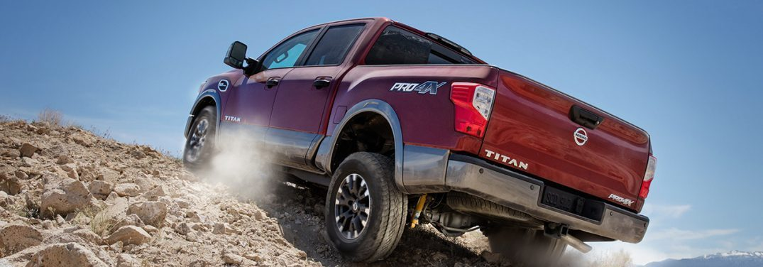 2017 Nissan Titan driving up a rocky hill