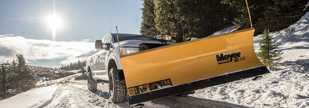 The 2018 Nissan Titan XD equipped with a yellow Meyer snow plow