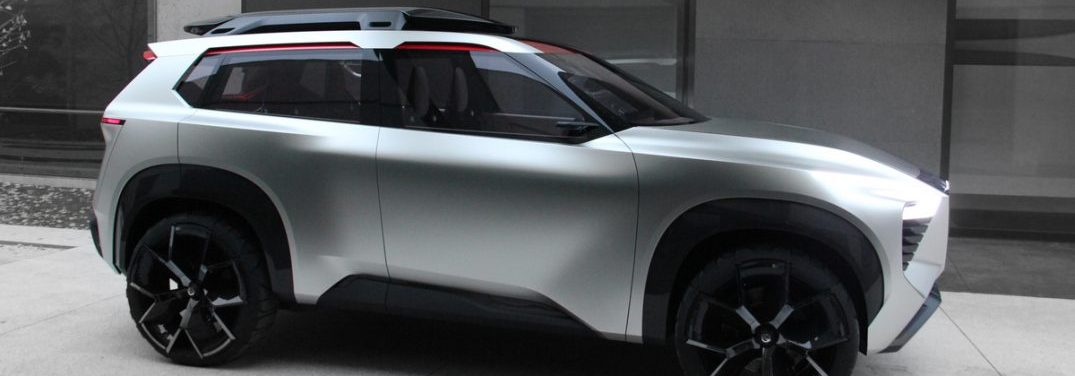 Side profile of the Nissan Xmotion concept vehicle outside of a gray concrete building