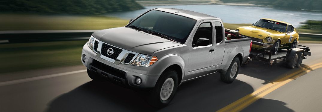 silver 2018 nissan frontier towing classic car