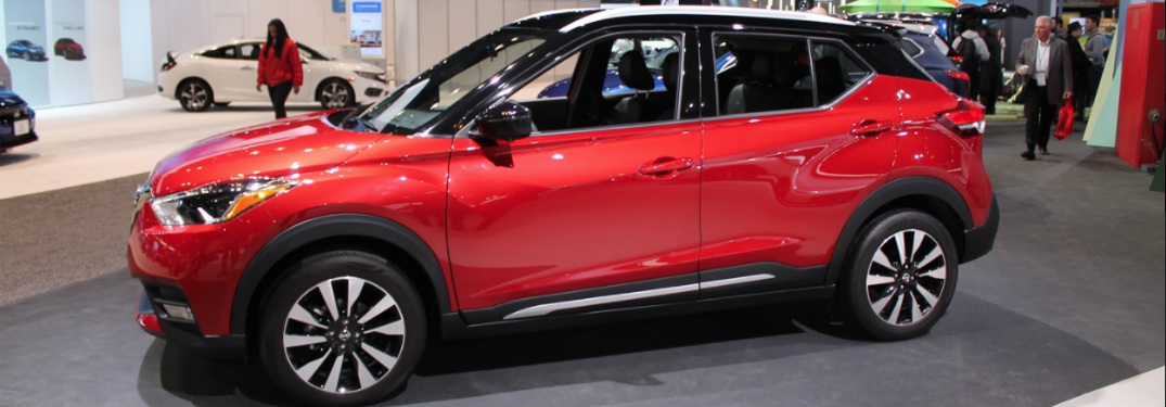 side view of red and black 2018 nissan kicks at 2018 chicago auto show