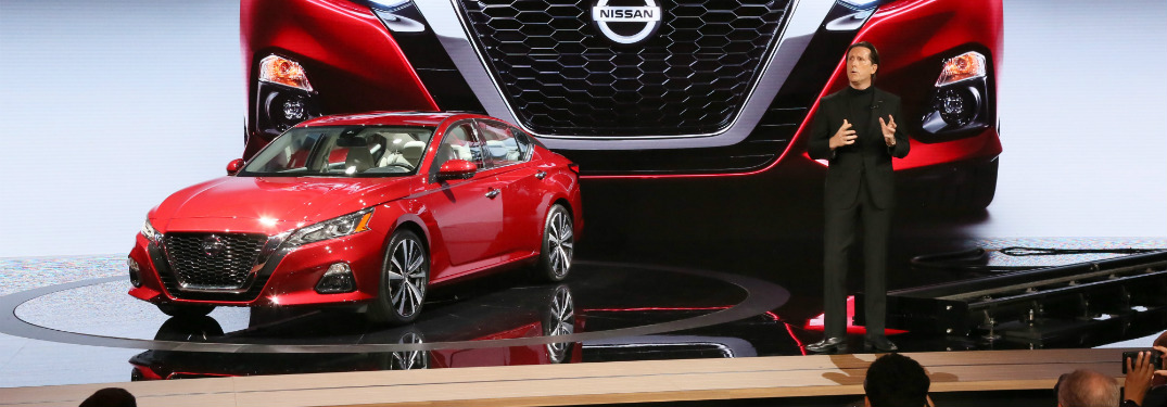 red 2019 nissan altima on display at 2018 new york international auto show