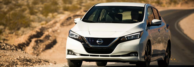 white 2018 nissan leaf driving on desert highway