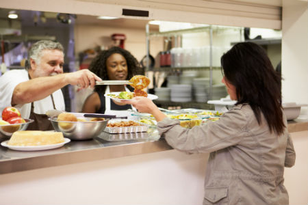 Volunteering in a soup kitchen