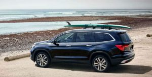 2018 Honda Pilot with a surfboard on top
