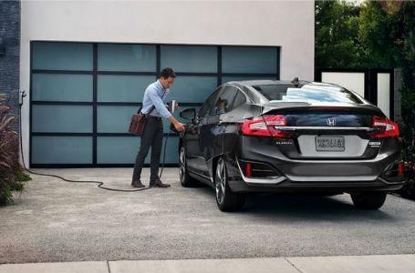 a man charging his 2018 Honda Clarity Plug-in Hybrid
