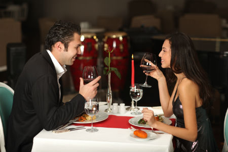 fancy couple having a romantic candlelit dinner