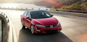 2017 Honda Clarity Fuel Cell driving on a bridge