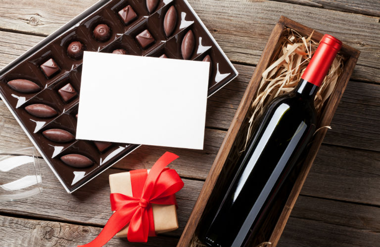 chocolates, wine, a gift and a card for Valentine's Day