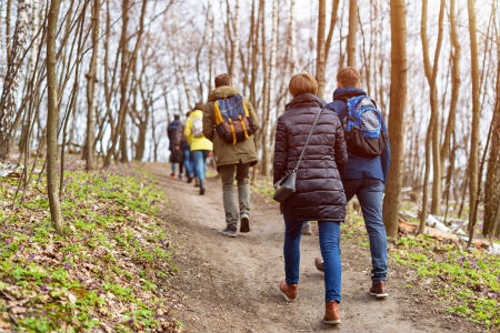 friends hiking on a trail in spring