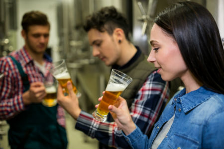 people tasting beer on a brewery tour