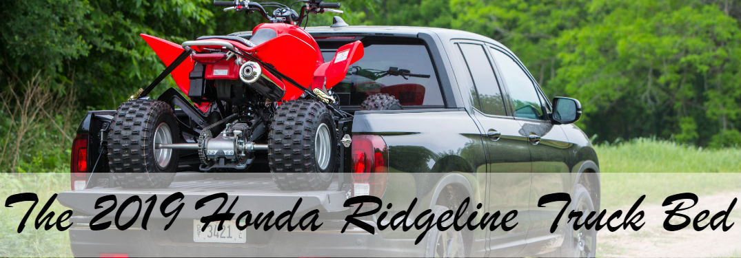 "image of the 2019 Honda Ridgeline with a four-wheeler secured in the truck bed with text saying: ""The 2019 Honda Ridgeline Truck Bed"""