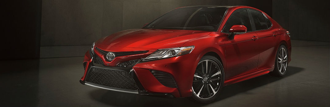 2018 toyota camry in a dark room with a black backdrop