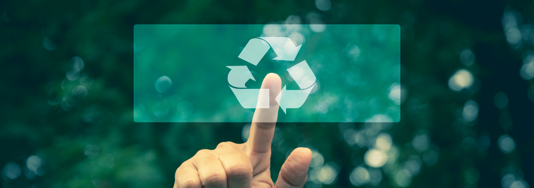 person pointing at the recycling symbol