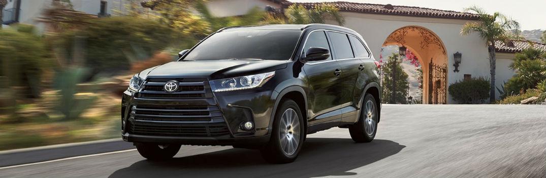 black 2018 Toyota Highlander on the road