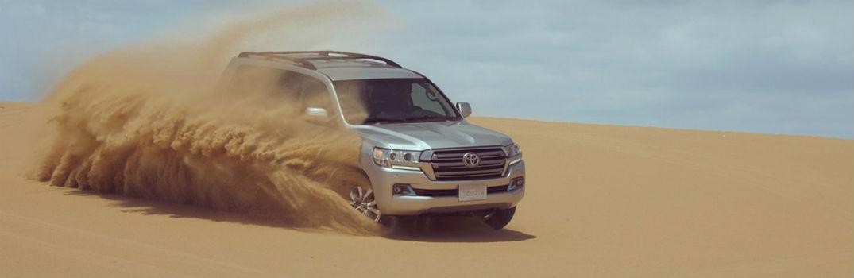 2018 Toyota Land Cruiser driving through a desert