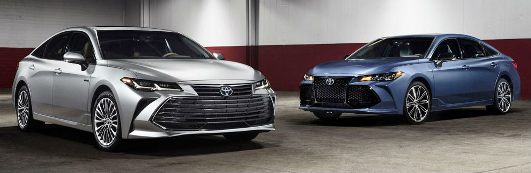 two 2019 Toyota Avalons parked in a garage