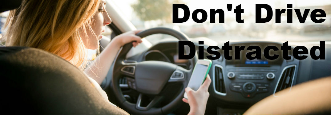 image of women texting and driving - Don't Drive Distracted - Distracted Driving Awareness Month