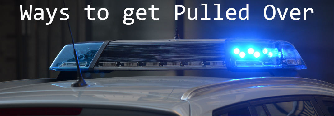 Common Reasons to be Pulled Over with image of flashing lights on top of a police cruiser