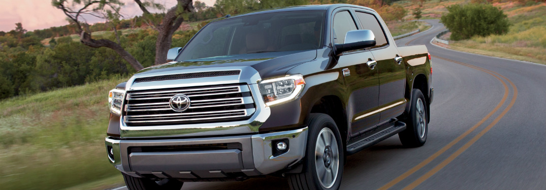 blue 2018 toyota tundra driving on empty country road