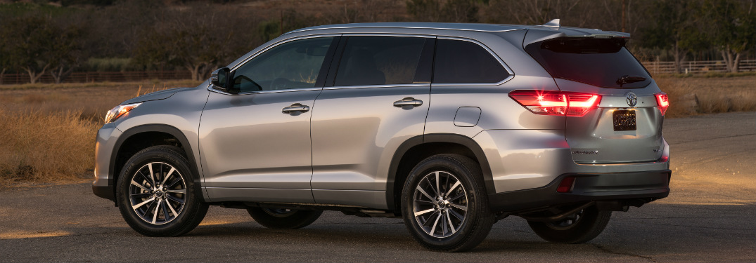 side view of silver 2018 toyota highlander alone at dusk