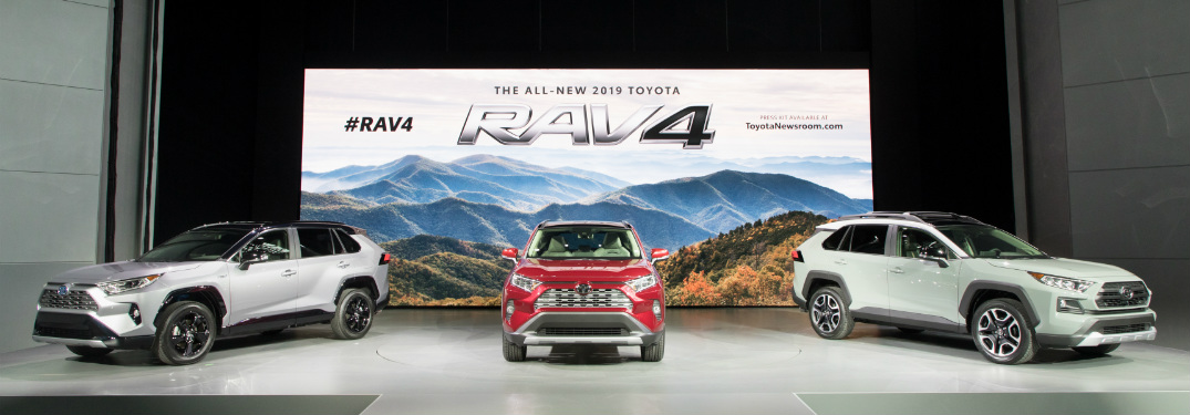 silver, red and white 2019 toyota rav4 on display at 2018 new york international auto show