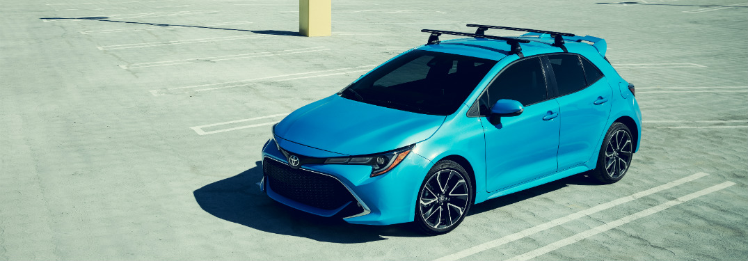 blue 2019 toyota corolla hatchback in empty parking lot