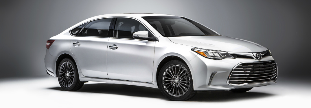 full view of white 2018 toyota avalon against white background