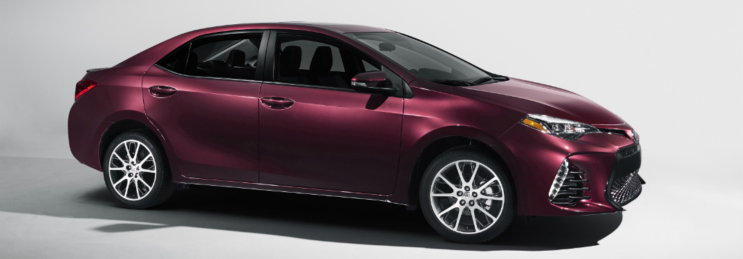 purple-red 2018 toyota corolla against white background