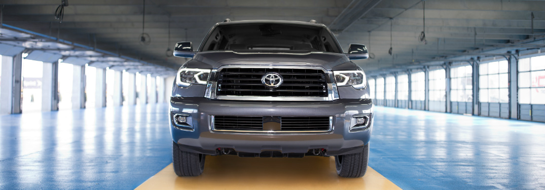 front grille and bumper of gray 2018 toyota sequoia in large, empty warehouse
