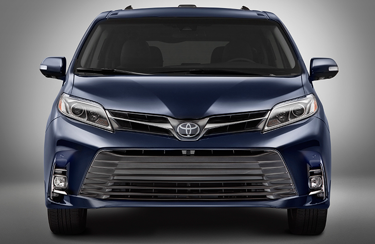 Front Shot Of 2018 Toyota Sienna Minivan With Headlights And Grille  Prominent