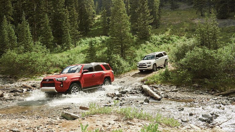 2 2018 Toyota 4Runners driving through the woods together