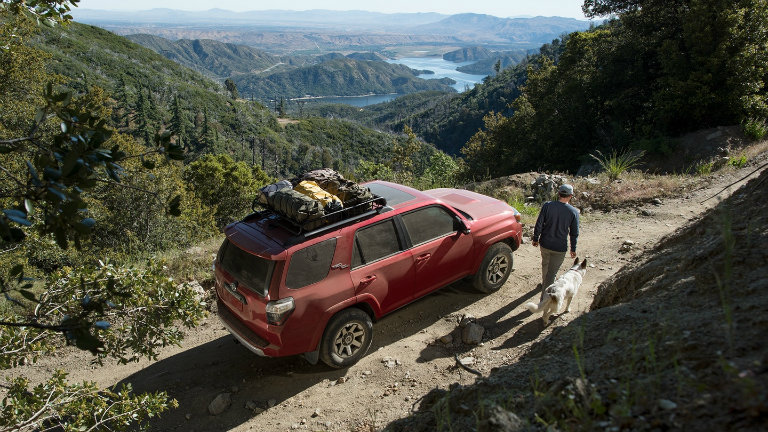 Red 2018 4Runner Sitting On A Cliff On Top Of A Mountain.