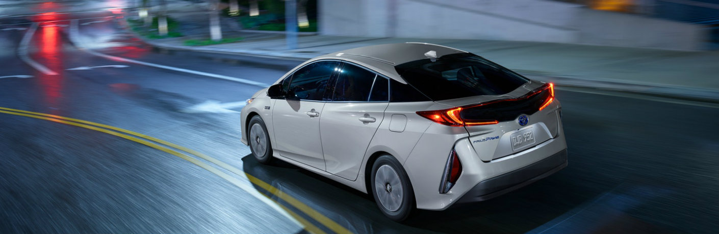 White Toyota Prius Prime driving down the highway