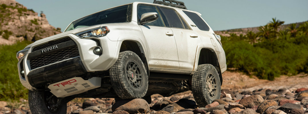 White 2019 Toyota 4Runner driving over rocky terrain