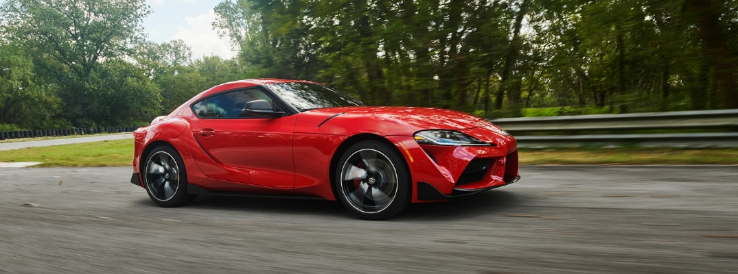 Profile view of 2020 Toyota Supra driving on highway