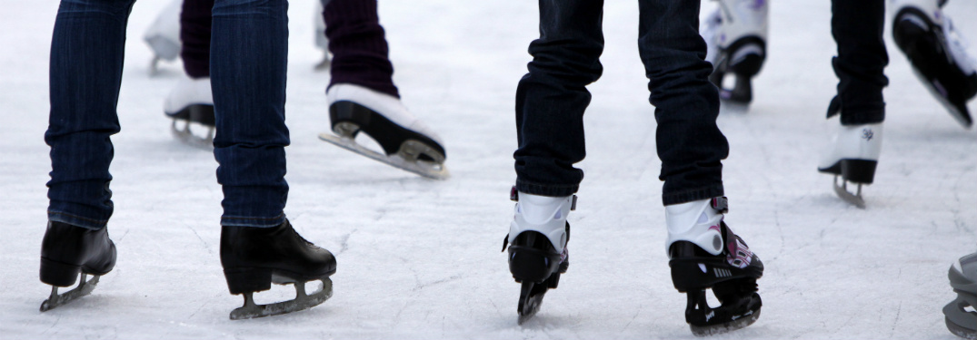 people ice skating together outside