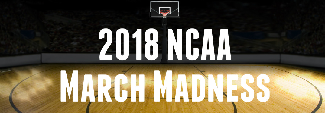 2018 NCAA March Madness text on basketball court