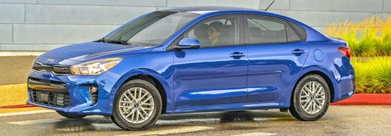 2020 Kia Rio blue exterior front fascia driver side parked woman inside