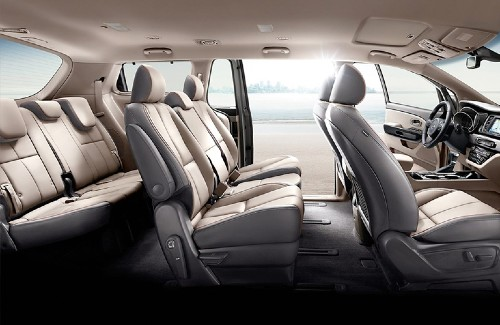 2020 Kia Sedona interior side view of first second and third row seats