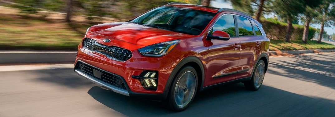 2020 Kia Niro red exterior front driver side driving on road