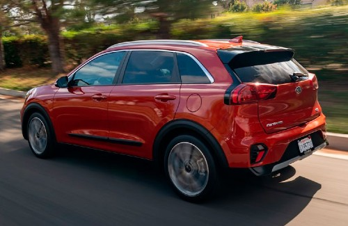2020 Kia Niro red exterior rear driver side driving on road
