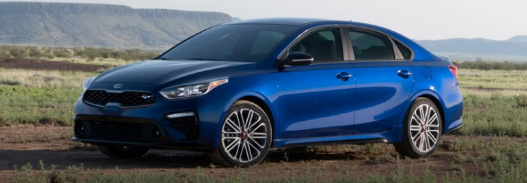 2020 Kia Forte blue exterior front driver side parked in field