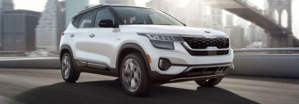 2021 Kia Seltos white exterior front fascia passenger side driving