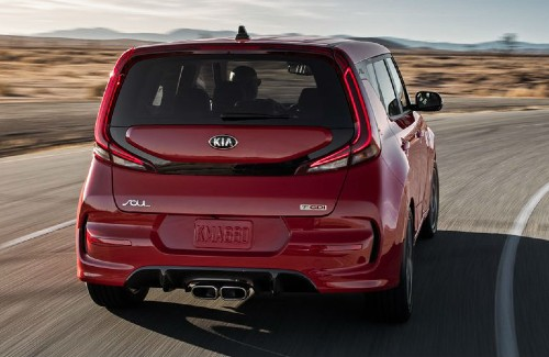 2021 Kia Soul red exterior rear driving in desert area