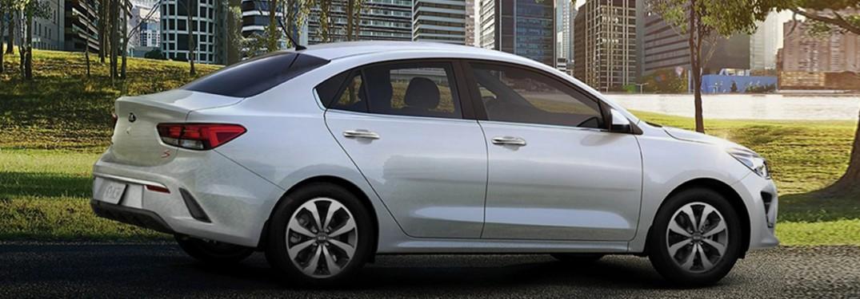 2021 Kia Rio white exterior passenger fascia parked in park