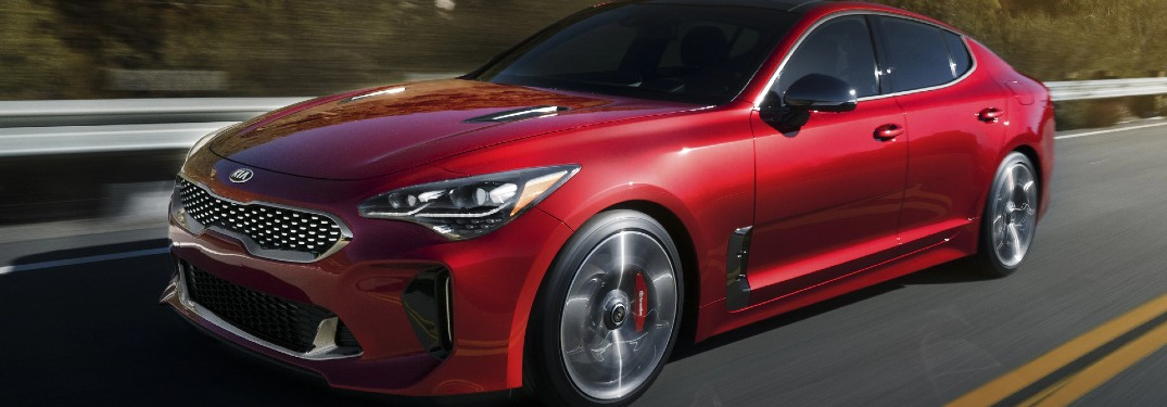 2021 Kia Stinger red exterior front fascia driving on highway