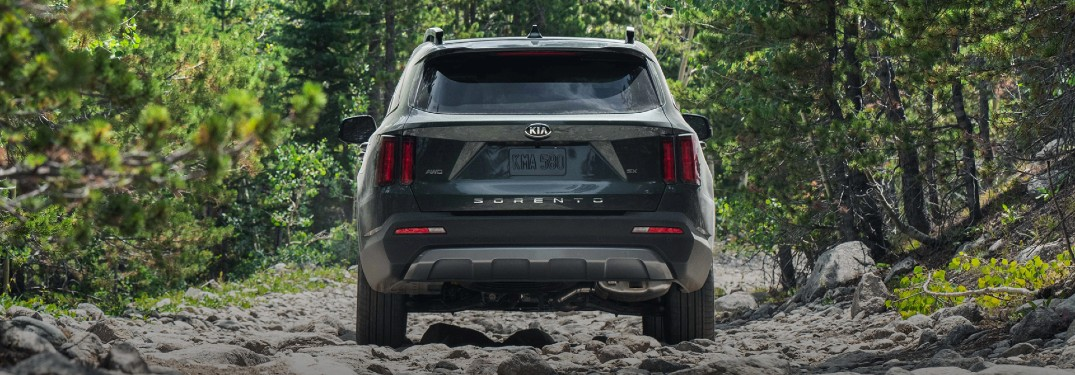 2021 Kia Sorento black exterior rear fascia driving on rocky path in forest
