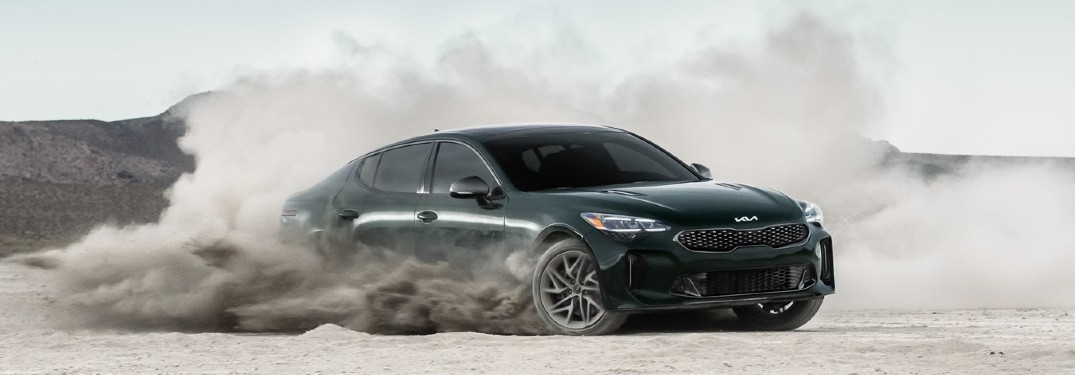 2022 Kia Stinger dark green exterior drifting in desert