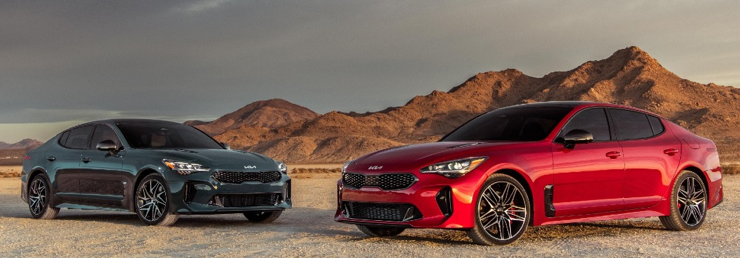 two 2022 Kia Stinger models parked in desert